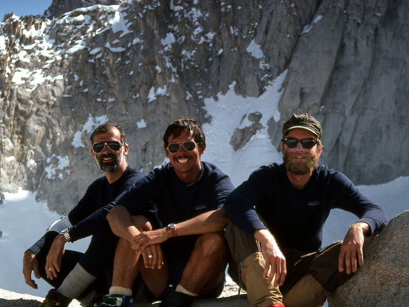 Three guys sitting after a successful ascent of Mount Whitney, California